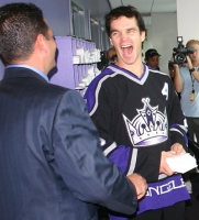 Luc Robitaille shares a laugh with Kings VP Mike Altieri
