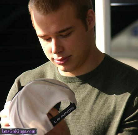 Dustin signs a hat