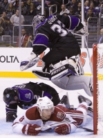 Matt Greene And Scotty Upshall Slide Under Jonathan Quick