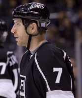 Scuderi Returns After Being Hit In The Nose With A Puck