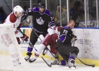 Michael Pelech Protects The Puck