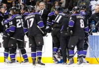 Kings Coach Terry Murray Watch As His Star Player Is Helped Off The Ice