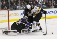 Quick Pokes The Puck Away From Nathan Horton