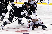 Marcus Kruger grabs the puck