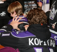 Anze Kopitar Signs A Kids Jersey