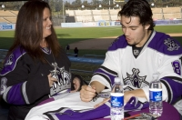 Drew Doughty Signs For A Fan