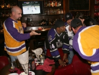 Team Lubo Brain Trust mingle as the Kings play on TV